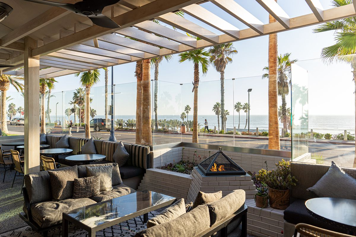 The outdoor patio with a view of the beach and ocean.