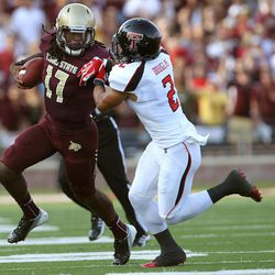 Texas State's Shaun Rutherford tries to get by Texas Tech's Cornelius Douglas during their NCAA college football game in San Marcos, Texas, Saturday, Sept. 8, 2012.