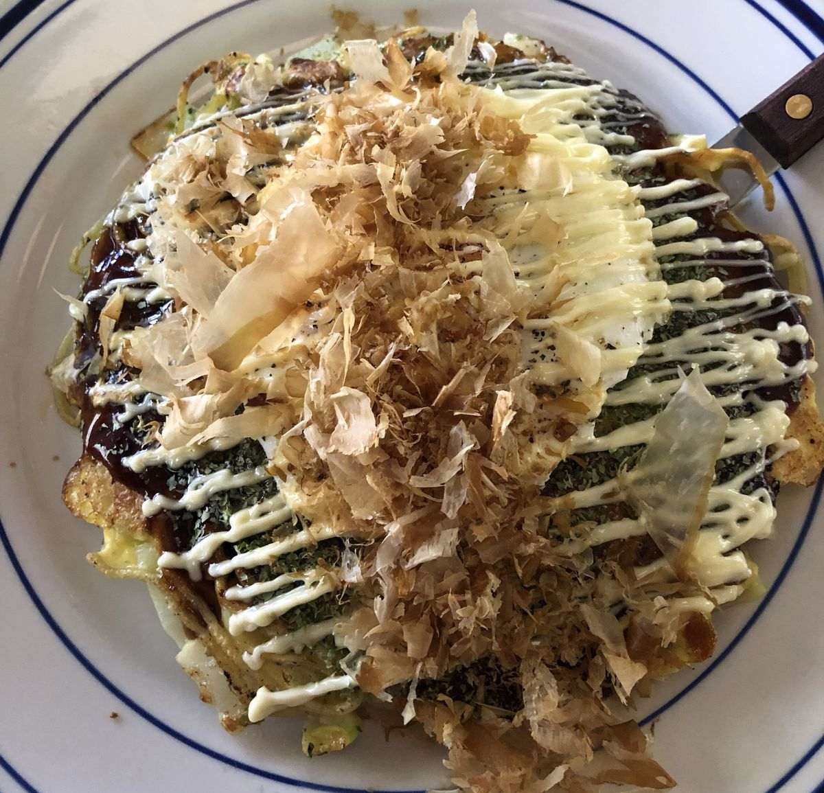 A close up of okonomiyaki.
