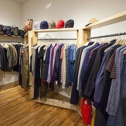 Men's merchandise—including cashmere beanies—fills the back right corner of the store.
