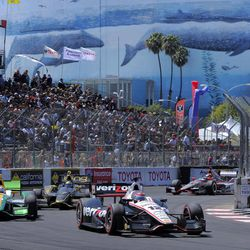 Will Power, of Australia, races in front of Simona de Silvestro, left, of Switzerland, and Sebastien Bourdais (7), of France, as the Long Beach convention center stands in the background, during the IndyCar Series' Grand Prix of Long Beach auto race, Sunday, April 15, 2012, in Long Beach, Calif. Power won the race.