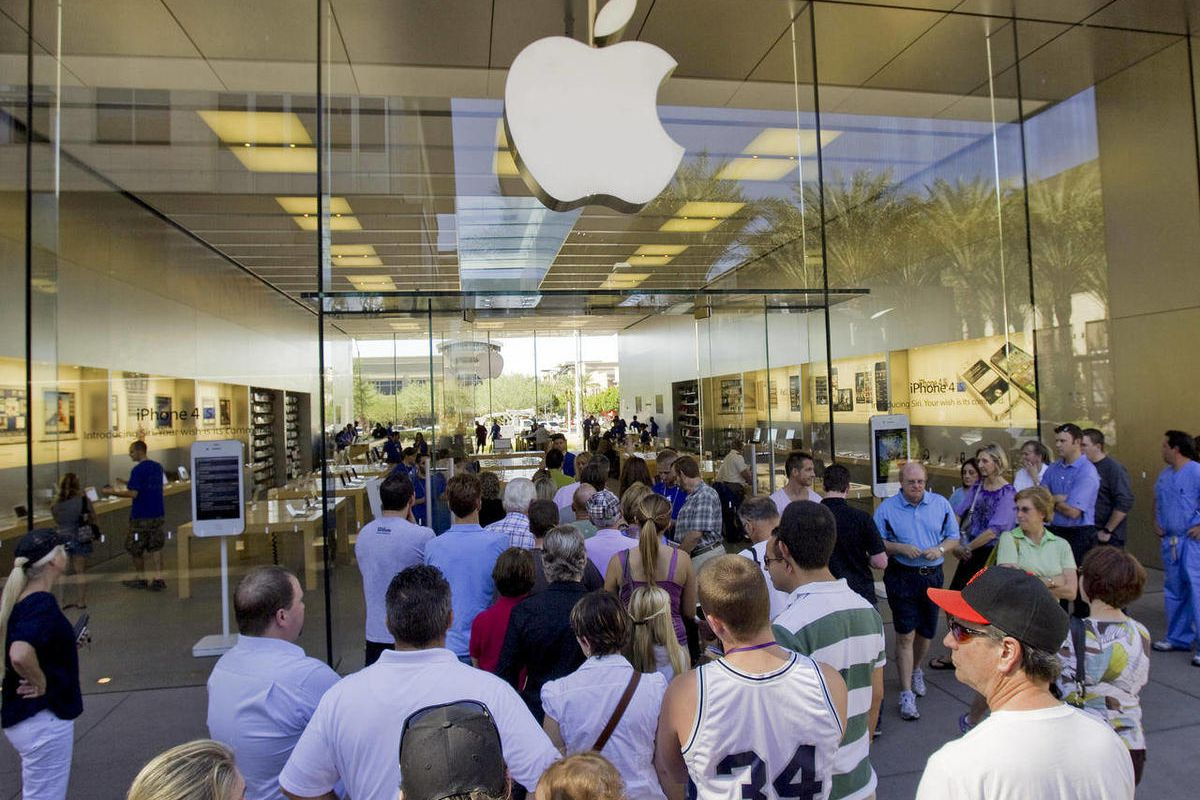 FILE- In this Wednesday, Oct. 19, 2011, file photo, a line of customers enter an Apple store  in Scottsdale, Ariz. Delivery times climbed quickly as Apple Inc. started taking orders for the iPhone 5 on Friday, Sept. 14, 2012, suggesting strong demand.