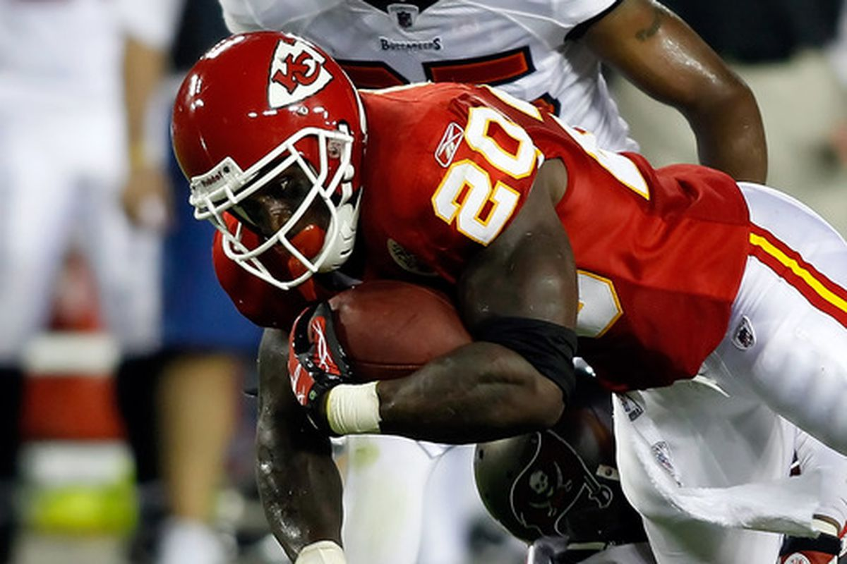 TAMPA FL - AUGUST 21:  Running back Thomas Jones #20 of the Kansas City Chiefs runs the ball against the Tampa Bay Buccaneers during a preseason game at Raymond James Stadium on August 21 2010 in Tampa Florida.  (Photo by J. Meric/Getty Images)