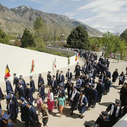 Graduates walk during academic procession during BYU Spring 2014 Commencement exercises in Provo Thursday, April 24, 2014.