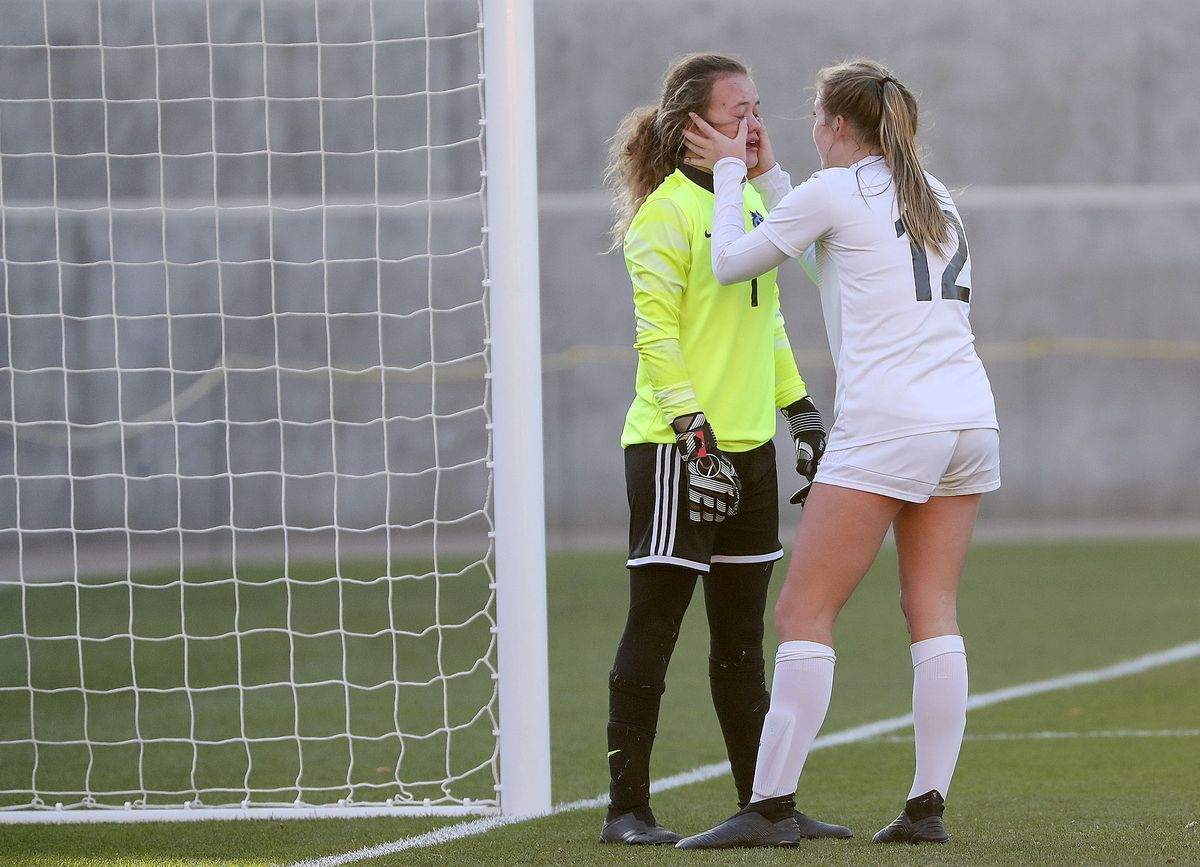Real Salt Lake Academy's Liv Watt wipes tears away from Real Salt Lake Academy's goalkeeper Emma Beavin after Rowland Hall scored their third goal in the 2A girls soccer championship game at Rio Tinto Stadium in Sandy on Monday, Oct. 26, 2020. Rowland Hall won 3-2.