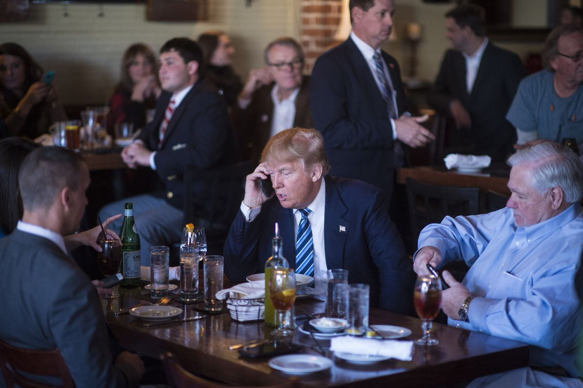 Donald Trump takes a phone call while campaigning in South Carolina.
