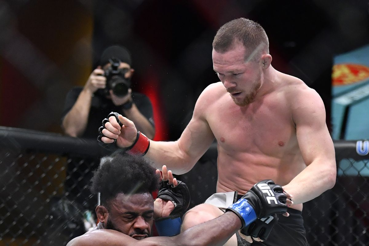 Petr Yan lands an illegal knee to the head of Aljmain Sterling in their UFC 259 bantamweight title fight.