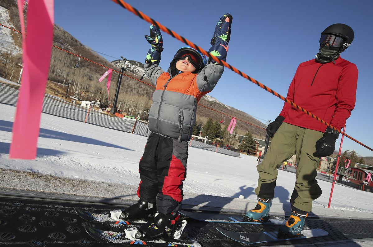 Blaine Gilmore, 2, enjoys Mine Cart lift with his father, Roland Gilmore, as Park City Mountain Resort in Park City opens for the 2020-21 ski season on Friday, Nov. 20, 2020.