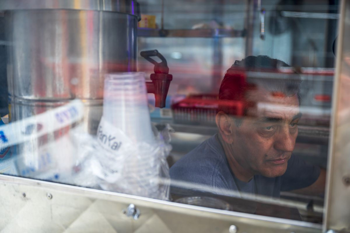 Afghanistan-born Bashir Saleh, 64, in his coffee and pastries food cart on West 43rd Street.