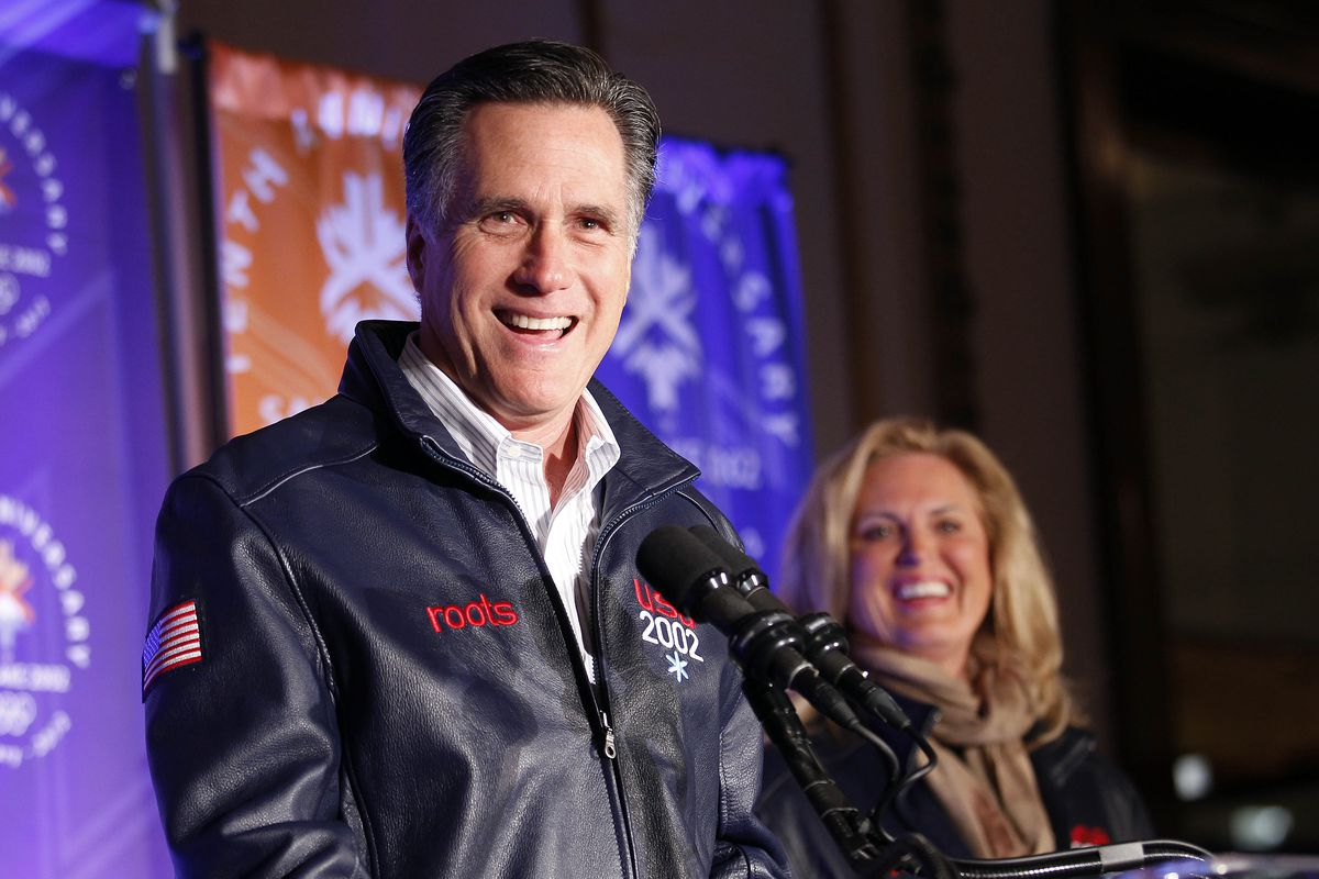 Republican presidential candidate, former Massachusetts Gov. Mitt Romney, speaks to a group of former Salt Lake City Olympic committee members, at an event marking the tenth anniversary of the games, in Salt Lake City, Utah, Saturday, Feb. 18, 2012. Behind is his wife Ann. (AP Photo/Gerald Herbert)