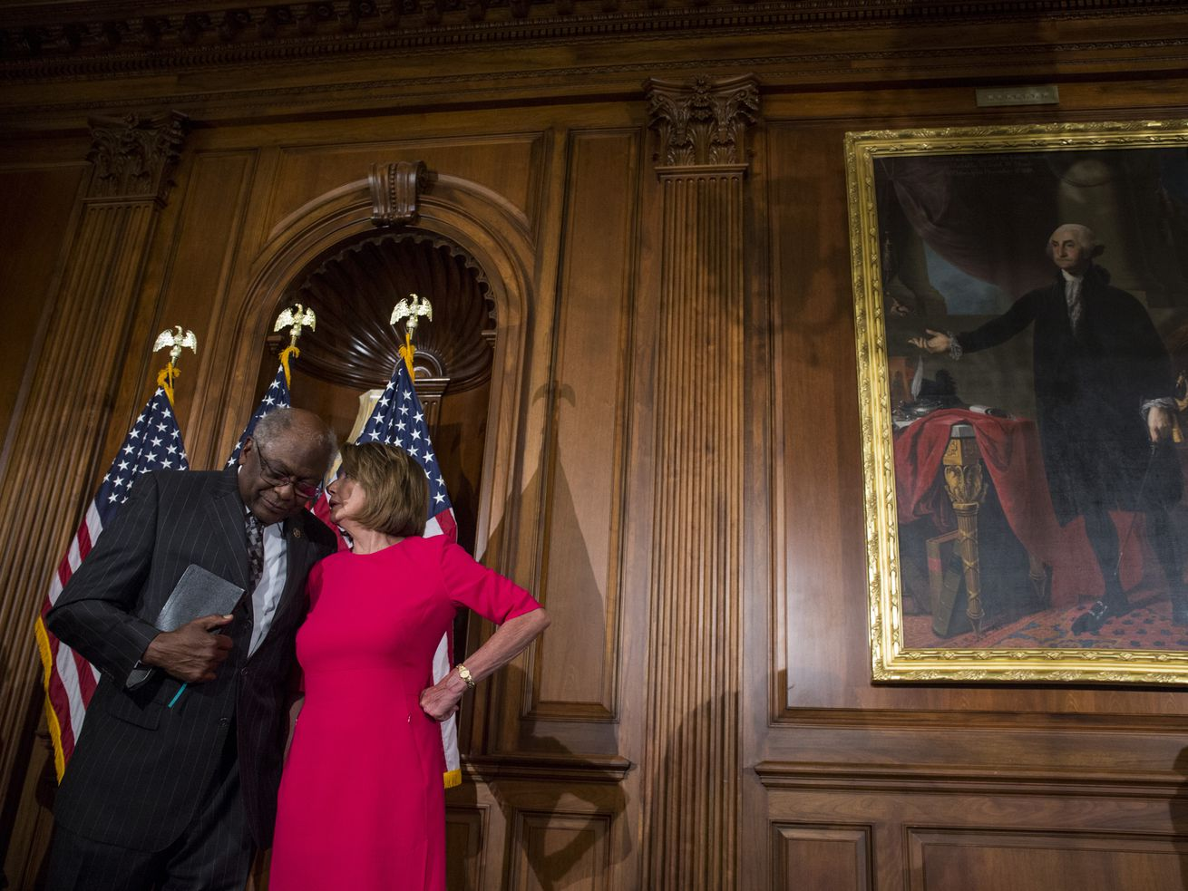 House Majority Whip Jim Clyburn speaks to House Speaker Nancy Pelosi in Washington.
