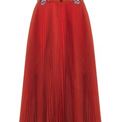 A red, pleated dress with floral accents.