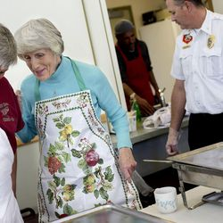 Ed Snoddy and Pamela Atkinson chat before serving Thanksgiving dinner to the residents of Grace Mary Manor in South Salt Lake on Tuesday, Nov. 22, 2016.