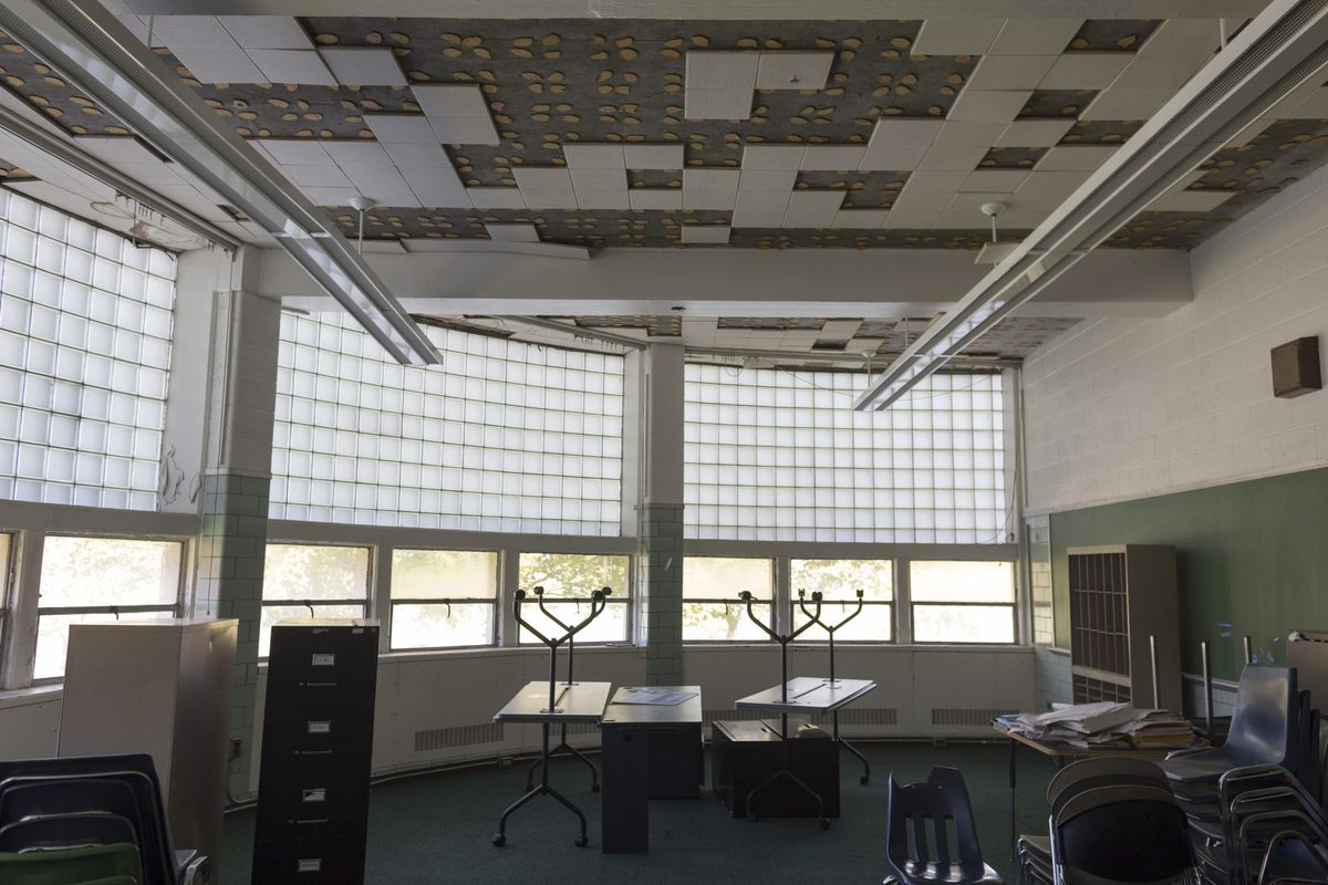 Some classrooms at Cody High School, including this room, can't be used because of ceiling damage caused by water.