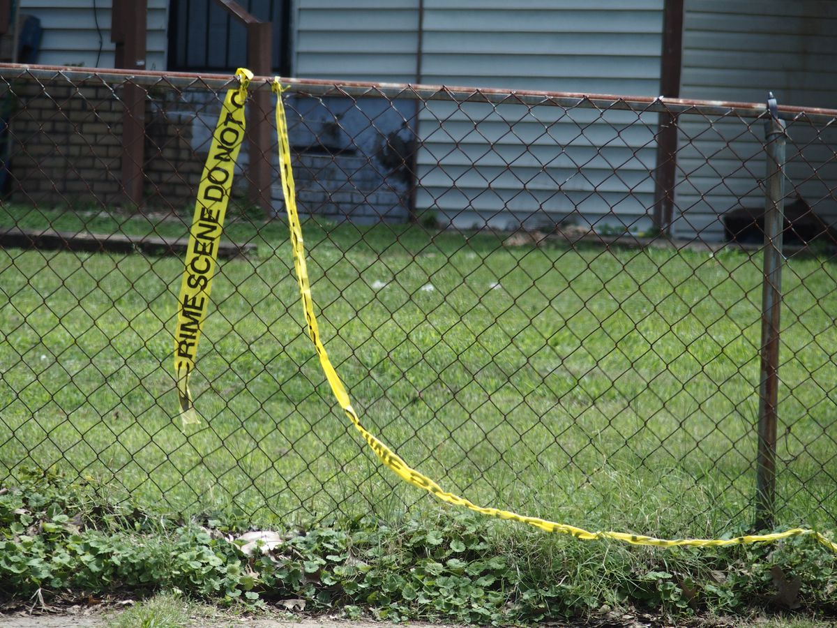 Police tape left at the house in Frayser where federal officers say Brandon Webber rammed their vehicles and came out with a weapon before they shot and killed him. Wednesday.