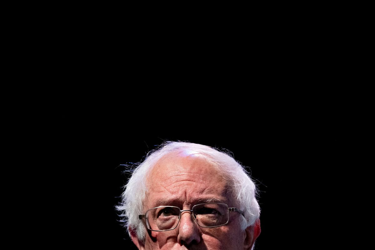 Bernie Sanders' face in front of a black background.