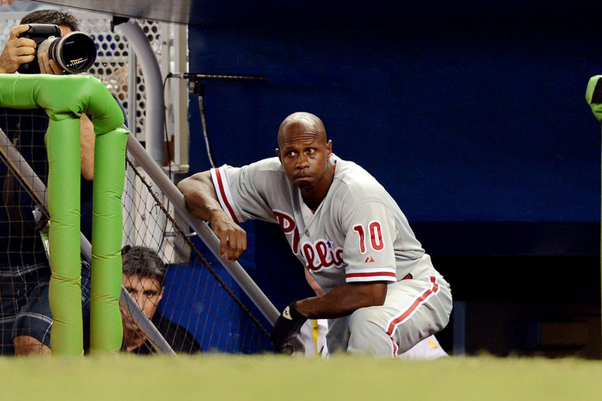 June 30, 2012; Miami, FL, USA; Philadelphia Phillies left fielder Juan Pierre (10) looks on from the dugout during the ninth inning against the Miami Marlins at Marlins Park. The Marlins won 3-2. Mandatory Credit: Steve Mitchell-US PRESSWIRE