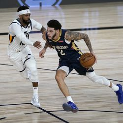 New Orleans Pelicans' Lonzo Ball (2) heads to the basket past Utah Jazz's Mike Conley during the second half of an NBA basketball game Thursday, July 30, 2020, in Lake Buena Vista, Fla. (AP Photo/Ashley Landis, Pool)