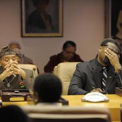 Detroit City Council members Kwame Kenyatta and James Tate react to the comments made by fellow council member Brenda Jones on keeping the consent agreement open to the public, Monday, April 2, 2012. As a possible vote on the consent agreement maybe delayed.