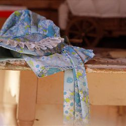 A bonnet rests on an old table inside the Daughters of the Utah Pioneers' recently refurbished historic cabin in Santaquin.
