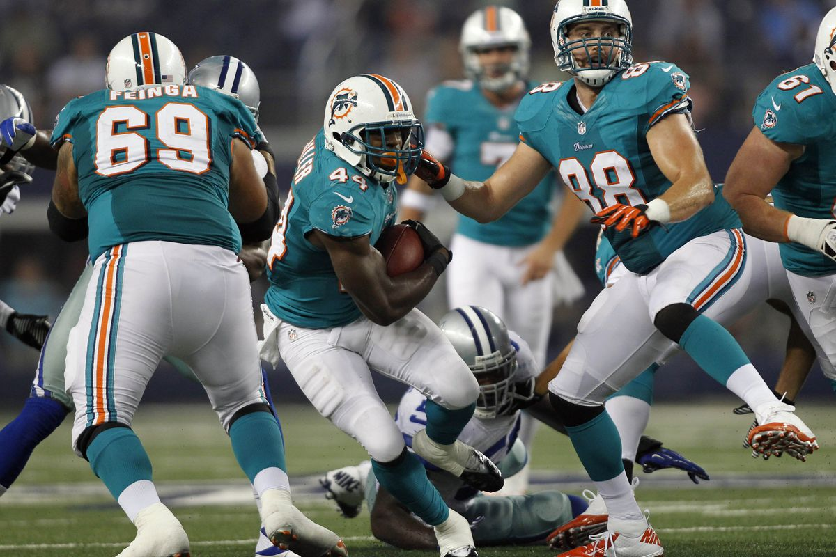 Aug 29, 2012; Arlington, TX, USA; Miami Dolphins running back Lamar Miller (44) carries the ball during the third quarter against the Dallas Cowboys at Cowboys Stadium. The Cowboys beat the Dolphins 30-13. Mandatory Credit: Tim Heitman-US PRESSWIRE