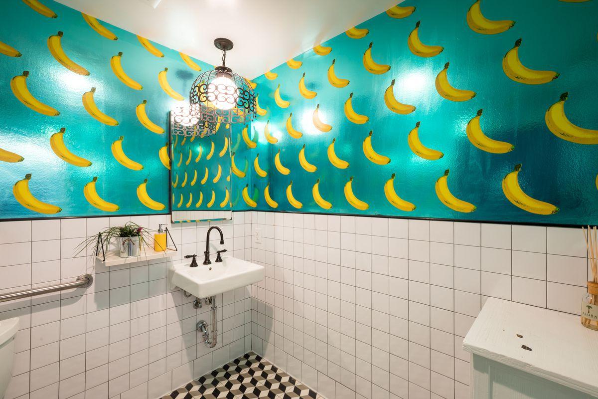 Metallic blue-green wallpaper with bananas