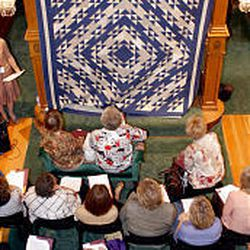 Quilters gather at the Colonial House in Salt Lake City for a sneak peak at the 2005 Holiday Quilt Show and Auction sponsored by the Deseret Foundation.