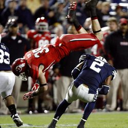 Going for the knock out Utah Utes defensive back Greg Bird (35) misses the tackle on Brigham Young Cougars wide receiver Cody Hoffman (2) as BYU and Utah play Saturday, Sept. 17, 2011. Utah won 54-10.