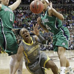 Baylor guard Odyssey Sims (0) heads to the floor and looses control of the ball as Notre Dame forward Natalie Achonwa (11) and Notre Dame guard Skylar Diggins (4) look on during the first half in the NCAA women's Final Four college basketball championship game, in Denver, Tuesday, April 3, 2012.  (AP Photo/Eric Gay)