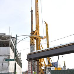 The broadcast cable bridge on Waveland, with equipment at work in the triangle lot -