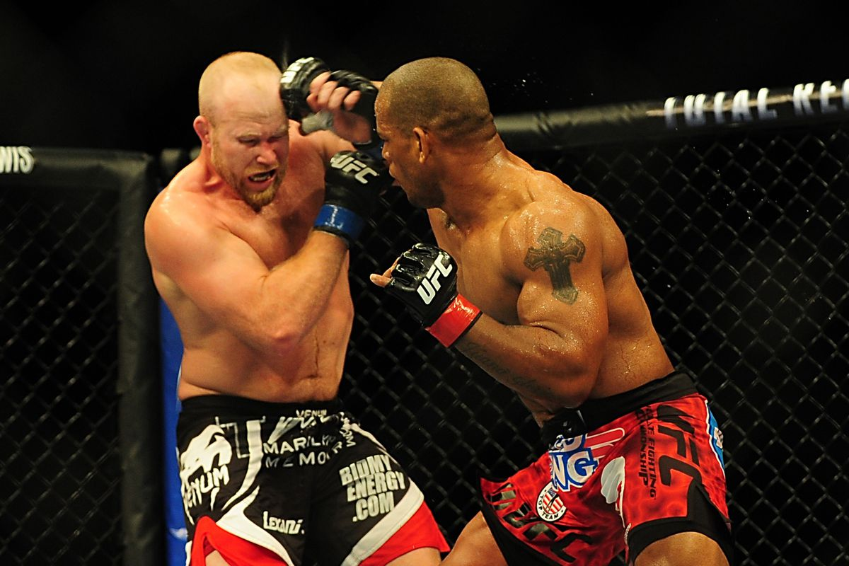 Jul 21, 2012; Calgary, AB, CANADA; Tim Boetsch (blue gloves) and Hector Lombard (red gloves) during the middleweight bout of UFC 149  at the Scotiabank Saddledome. Anne-Marie Sorvin-US PRESSWIRE