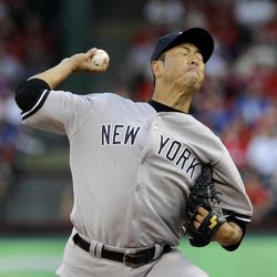 New York Yankees starting pitcher Hiroki Kuroda, of Japan, delivers to the Texas Rangers in the first inning of a baseball game Tuesday, April 24, 2012, in Arlington, Texas.