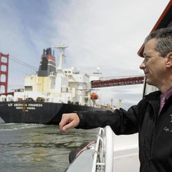 In this photo taken Wednesday April 25, 2012, Capt. Bruce A. Horton, president of the San Francisco Bar Pilots, watches as a tanker passes beneath the Golden Gate Bridge in San Francisco. Since the days of Mark Twain, the pilots have had it good. Thanks to political clout and highly specialized training, this cadre of 60 ship captains has for more than a century had control over guiding oil tankers and cargo ships in, out and around the San Francisco Bay.