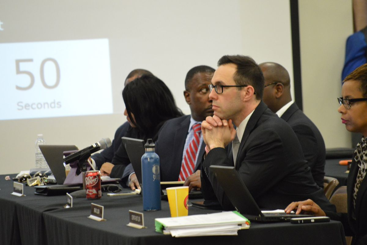 Shelby County Schools innovation chief Brad Leon listens to discussion during a recent school board meeting in Memphis.