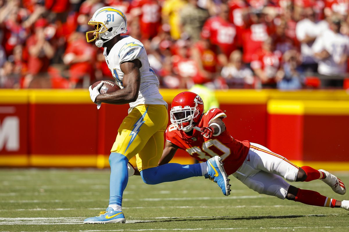 Mike Williams #81 of the Los Angeles Chargers runs past Deandre Baker #30 of the Kansas City Chiefs during the fourth quarter at Arrowhead Stadium on September 26, 2021 in Kansas City, Missouri.