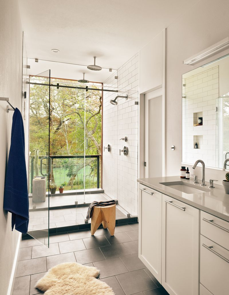 Bathroom with white walls and cabinets.