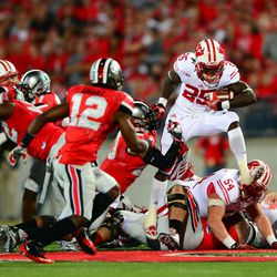 Gordon leap frogs his o-line and pursuing defenders.
