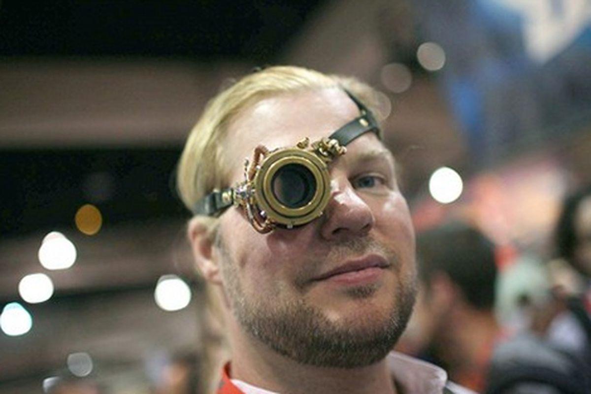 """A Steam Punk artist mechanizes the monocle at Comic-Con. Image via <a href=""""http://www.latimes.com/entertainment/news/la-et-comic-con-2009-pictures,0,6641295.photogallery?index=4"""">LA Times</a>"""