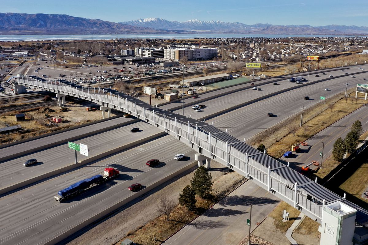 The new pedestrian bridge connecting Utah Valley Universitywith the Utah Transit Authority's FrontRunner Orem Central Station is pictured during its unveiling on Thursday, Jan.14, 2021. Crews will continue putting the finishing touches on the bridge over the next few weeks, with an expected opening in early February.