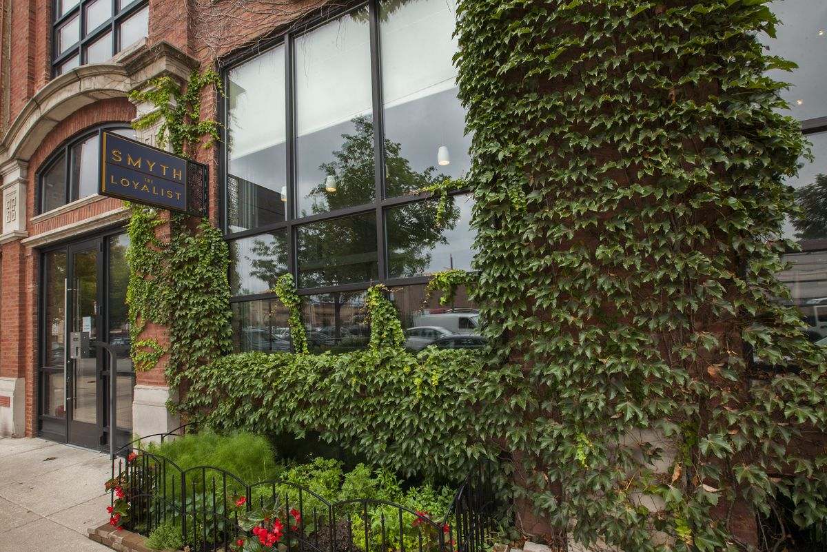 The exterior of a fine dining restaurant in the West Loop with lots of ivy