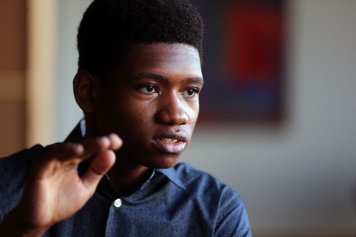 Getro Joseph, a young cellist from Haiti, answers a question during an interview at Abravanel Hall in Salt Lake City on Saturday, Dec. 7, 2019. Getro also met with Congressman Ben McAdams, who assisted Getro with the visa process for his trip to Utah.