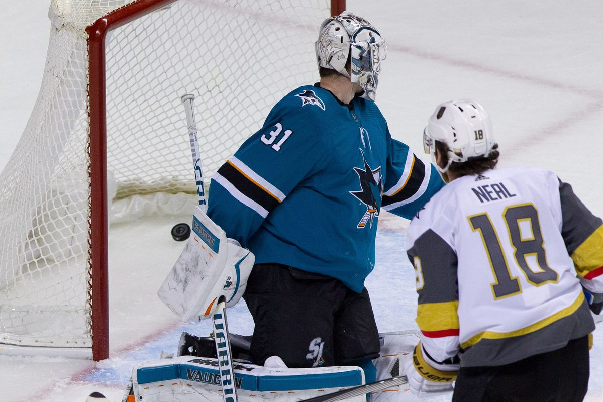 Feb 8, 2018; San Jose, CA, USA; San Jose Sharks goalie Martin Jones (31) turns to see the puck enter the net after a goal from Las Vegas Knights left wing James Neal (18) scores in the third period at SAP Center at San Jose. The Knights won 5-3.