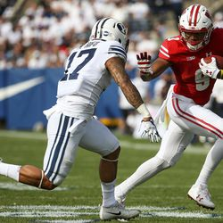 Wisconsin Badgers running back Rachid Ibrahim (9) runs against Brigham Young Cougars defensive back Marvin Hifo (17) during the game at LaVell Edwards Stadium in Provo on Saturday, Sept. 16, 2017.