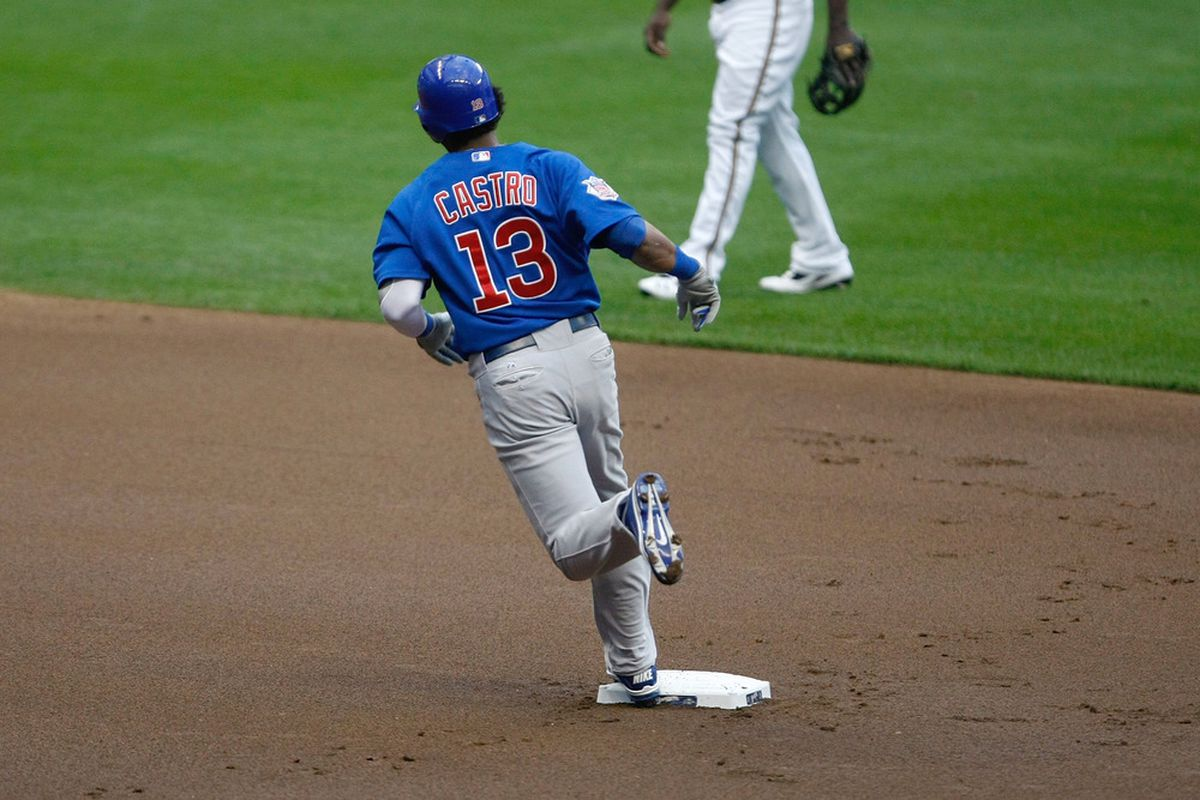 Starlin Castro of the Chicago Cubs steps on second base after hitting a home run in the first inning against the Milwaukee Brewers at Miller Park in Milwaukee, Wisconsin. (Photo by Scott Boehm/Getty Images)