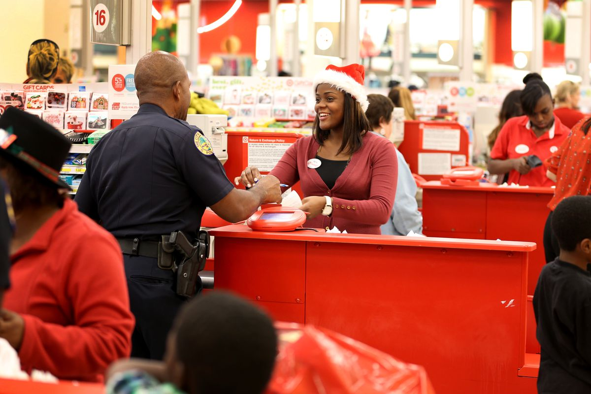 Marie Rivage works the cash register at a Target store on December 19, 2013 in Miami, Florida.