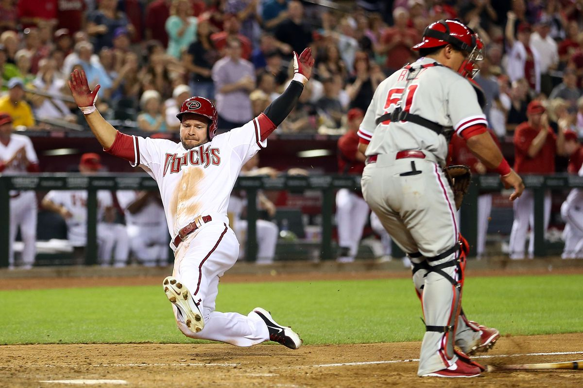 Cody Ross slides in with the tying run.