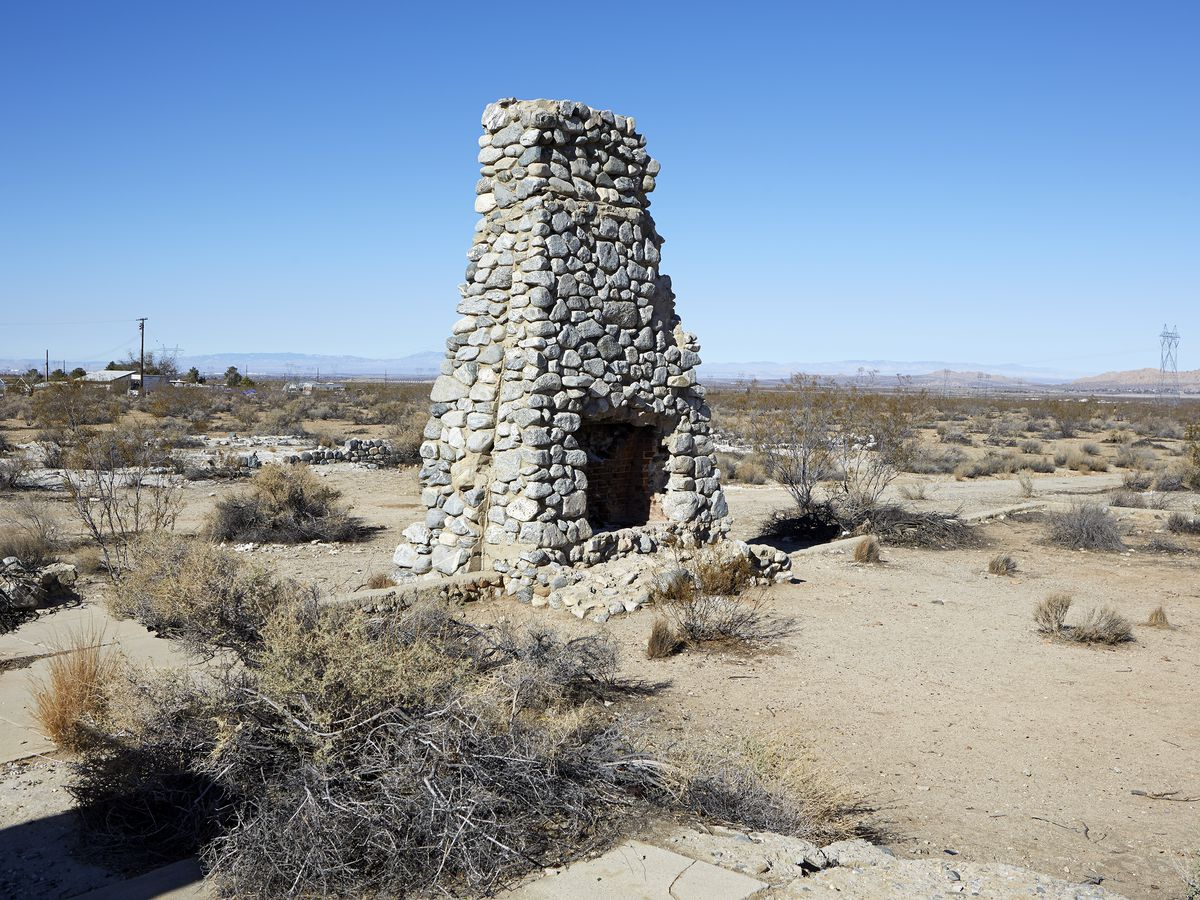 A stone fireplace in the middle of the desert, part of the ruins at Llano del Rio.