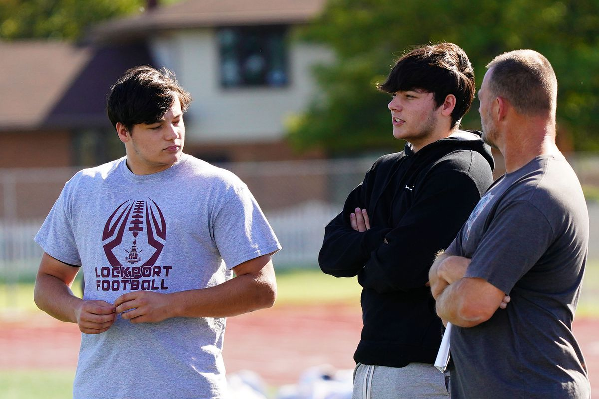 Cody and Cole Silzer at football practice in Lockport.