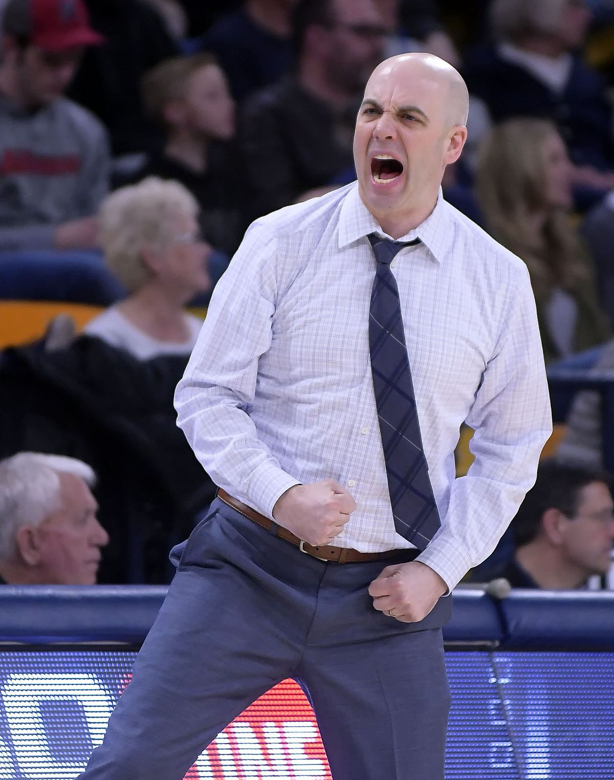 Utah State coach Craig Smith celebrates after a score against UNLV during an NCAA college basketball game Saturday, Feb. 2, 2019, in Logan, Utah. (Eli Lucero/The Herald Journal via AP)