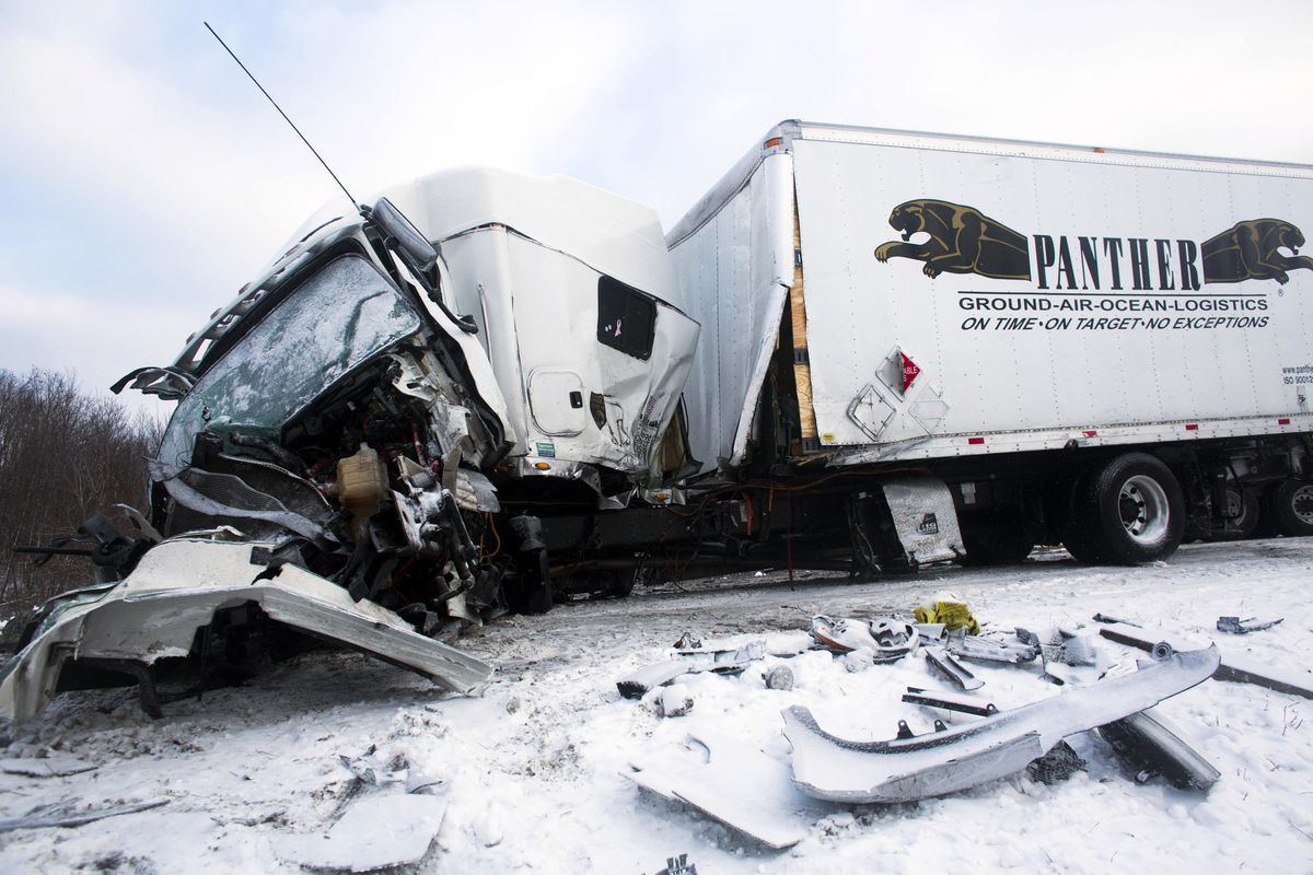 <small><strong>Road crews work to clear wrecked vehicles and debris along Interstate 94, Saturday, Jan. 10, 0215, the day after a series of crashes closed the highway between mile markers 88 and 92 in eastern Kalamazoo County, near Galesburg, Mich. The nu